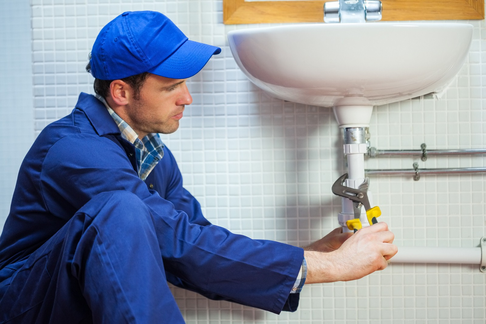 Plumber-Fixing-the-Sink.jpg